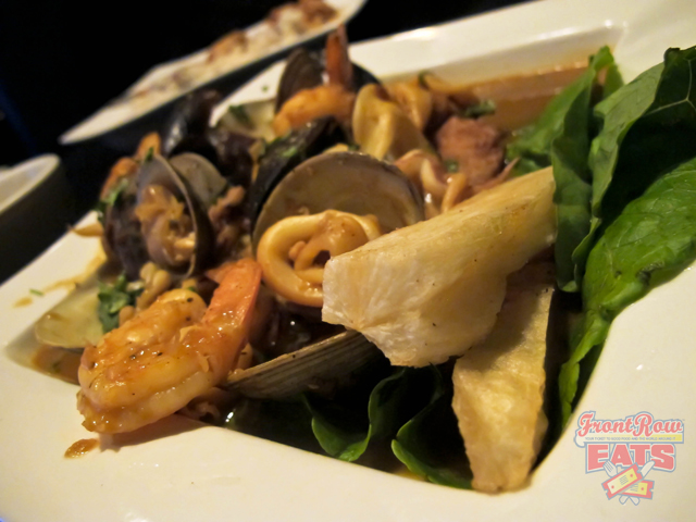 Fried tilapia with shrimp, squid, mussels, clams, and topped with aji panca-garlic cilantro, onion pureed, reduced with Cusquena beer, and served with fried yucca