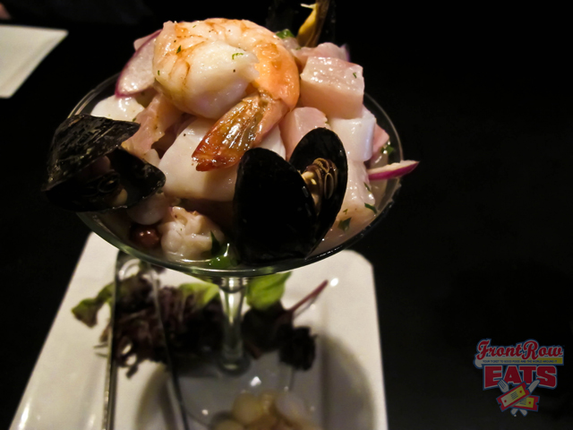 A medley of seafood tossed with a cilantro, rocoto, and garlic Leche de Tigre.