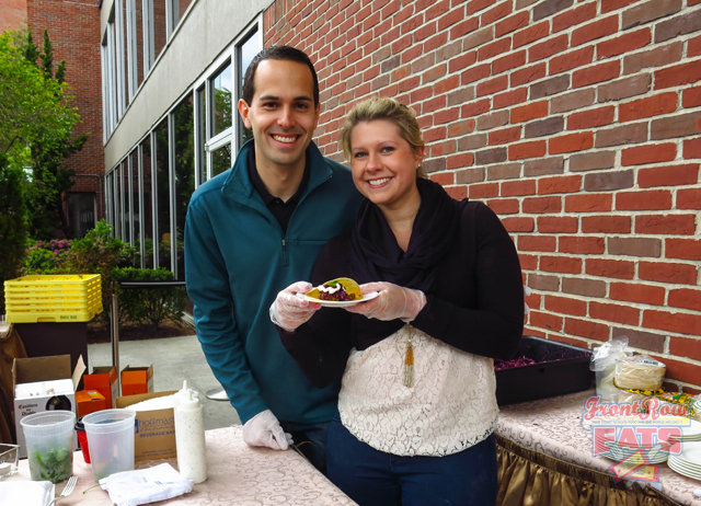 Nick and Monica Bucci holding a plate of their tasty creation.