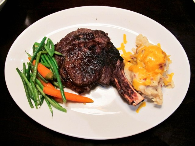 Fred & Steve's Famous 22 oz Prime Aged Cowboy Steak - Bone-in Marbled Rib-eye with Haricot Vert  and Baby Carrots with Cheddar Mashed Potatoes ($68)